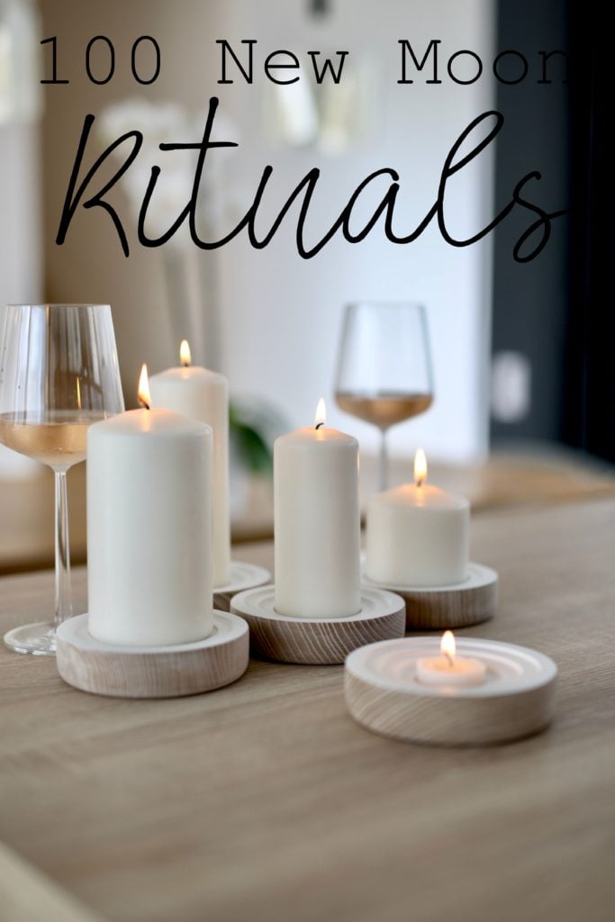 "White wine and candles on a tabletop with caption: ""100 New Moon Rituals"""